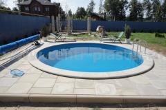 Фото№12 Круглый бассейн у загородного дома