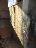 Фото №6. Процесс установки металлических листов поверх минваты.