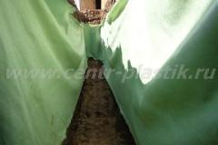 Фото №64 Укладка геоткани по стенкам филтрационного поля